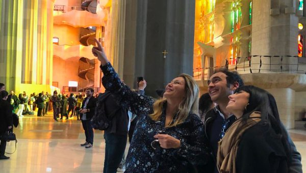 A tour guide showing tourists the interior of sagrada Familia on a private tour.